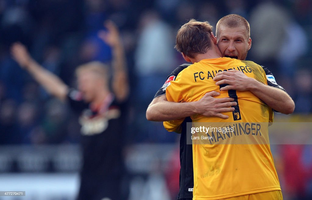 Ragnar Klavan of Augsburg celebrates with goalkeeper <a gi-track='captionPersonalityLinkClicked' href=/galleries/search?phrase=Alexander+Manninger&family=editorial&specificpeople=167082 ng-click='$event.stopPropagation()'>Alexander Manninger</a> after winning the Bundesluga match between Borussia Moenchengladbach and FC Augsburg at Borussia-Park on March 8, 2014 in Moenchengladbach, Germany.