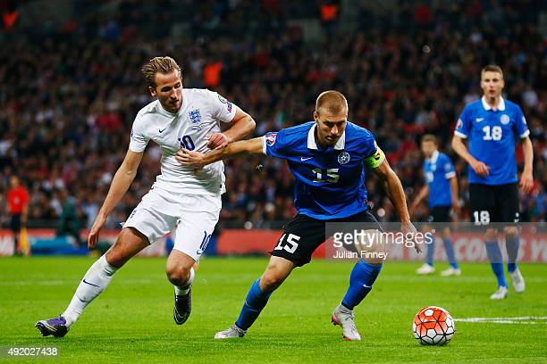 Ragnar Klavan of Estonia holds off Harry Kane of England during the UEFA EURO 2016 Group E qualifying match between England and Estonia at Wembley on...