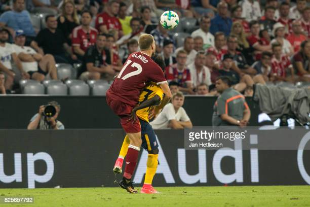 Ragnar Klavan of FC Liverpool fights for the ball during the Audi Cup 2017 match between Liverpool FC and Atletico Madrid at Allianz Arena on August...