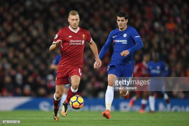 Ragnar Klavan of Liverpool and Alvaro Morata of Chelsea battle for the ball during the Premier League match between Liverpool and Chelsea at Anfield...