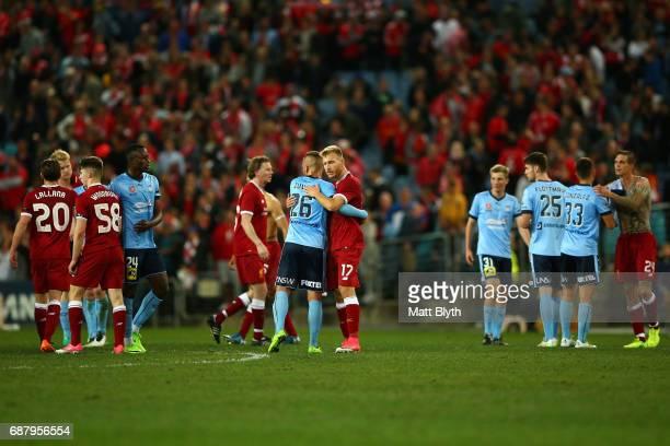 Ragnar Klavan of Liverpool and Chris Zuvela of Sydney FC embrace after the International Friendly match between Sydney FC and Liverpool FC at ANZ...