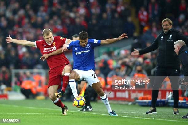 Ragnar Klavan of Liverpool and Dominic CalvertLewin of Everton battle for possession during the Premier League match between Liverpool and Everton at...