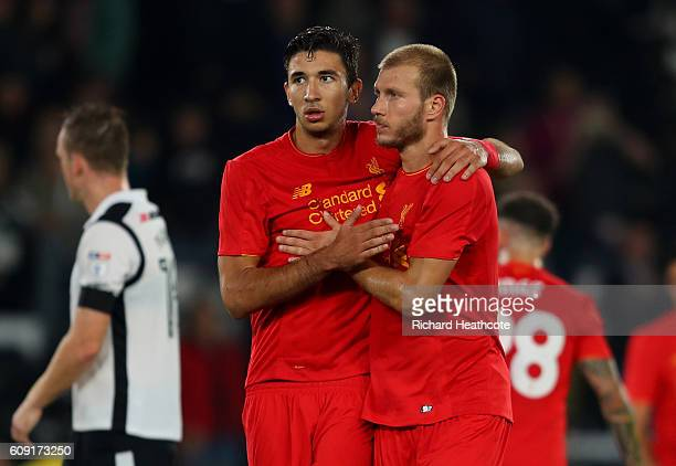 Ragnar Klavan of Liverpool and Marko Grujic of Liverpool celebrate victory during the EFL Cup Third Round match between Derby County and Liverpool at...