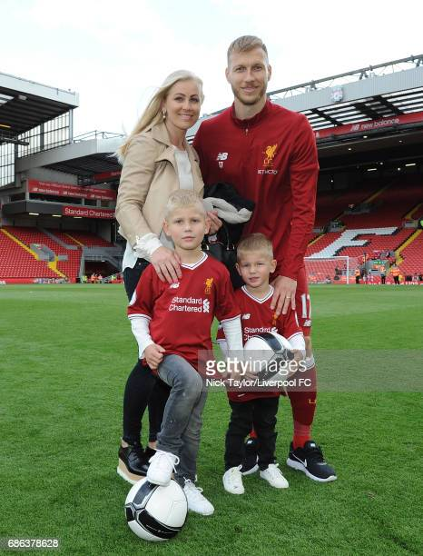 Ragnar Klavan Of Liverpool celebrates with family at the end of the Premier League match between Liverpool and Middlesbrough at Anfield on May 21...