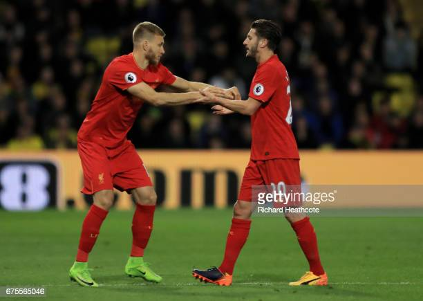 Ragnar Klavan of Liverpool comes on as a second half substitute for Adam Lallana of Liverpool during the Premier League match between Watford and...
