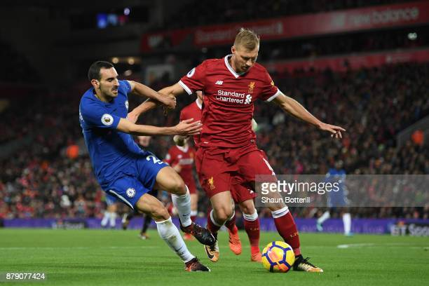 Ragnar Klavan of Liverpool competes for the ball with Davide Zappacosta of Chelsea during the Premier League match between Liverpool and Chelsea at...