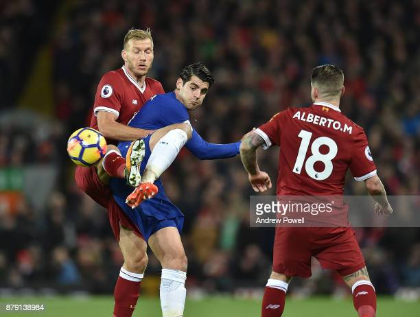 Ragnar Klavan of Liverpool competes with Alvaro Morata of Chelsea during the Premier League match between Liverpool and Chelsea at Anfield on...