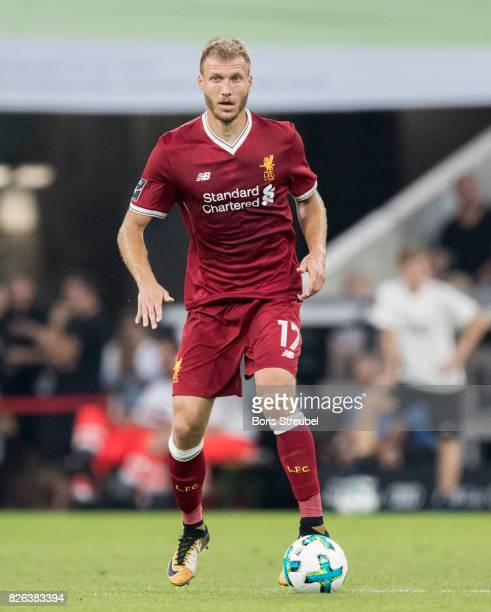 Ragnar Klavan of Liverpool FC runs with the ball during the Audi Cup 2017 match between Liverpool FC and Atletico Madrid at Allianz Arena on August 2...