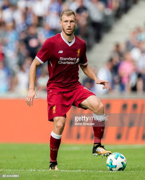 Ragnar Klavan of Liverpool FC runs with the ball during the Preseason Friendly match between Hertha BSC and FC Liverpool at Olympiastadion on July 29...