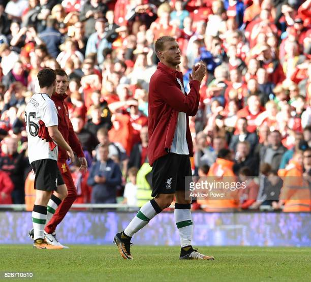 Ragnar Klavan of Liverpool shows his appreciation to the fans at the end of the pre season friendly match between Liverpool and Athletic Bilbao at...