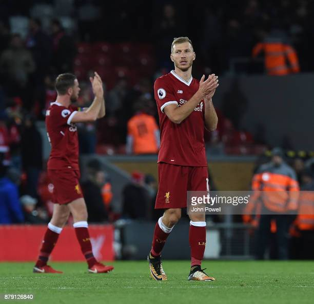 Ragnar Klavan of Liverpool shows his appreciation to the fans at the end of the Premier League match between Liverpool and Chelsea at Anfield on...