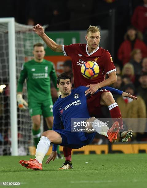 Ragnar Klavan of Liverpool with Alvaro Morata during the Premier League match between Liverpool and Chelsea at Anfield on November 25 2017 in...
