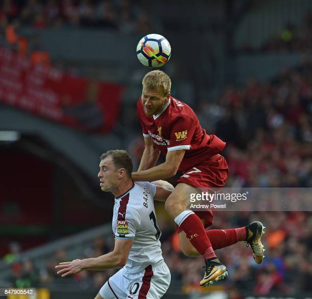 Ragnar Klavan of Liverpool with Ashley Barnes of Burnley during the Premier League match between Liverpool and Burnley at Anfield on September 16...