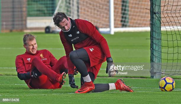 Ragnar Klavan with Danny Ward of Liverpool during a training session at Melwood Training Ground on December 8 2017 in Liverpool England