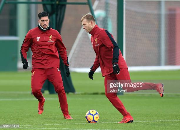 Ragnar Klavan with Emre Can of Liverpool during a training session at Melwood Training Ground on December 8 2017 in Liverpool England