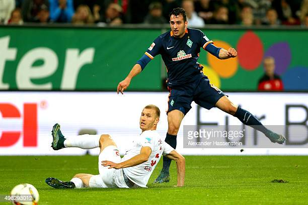 Ragnar Klaven of Augsburg battles for the ball with Levin Mete Oeztunali of Bremen during the Bundesliga match between FC Augsburg and SV Werder...