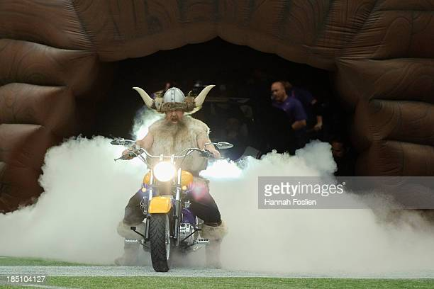 Ragnar mascot for the Minnesota Vikings drives his motorcycle onto the field before the game between the Minnesota Vikings and the Carolina Panthers...