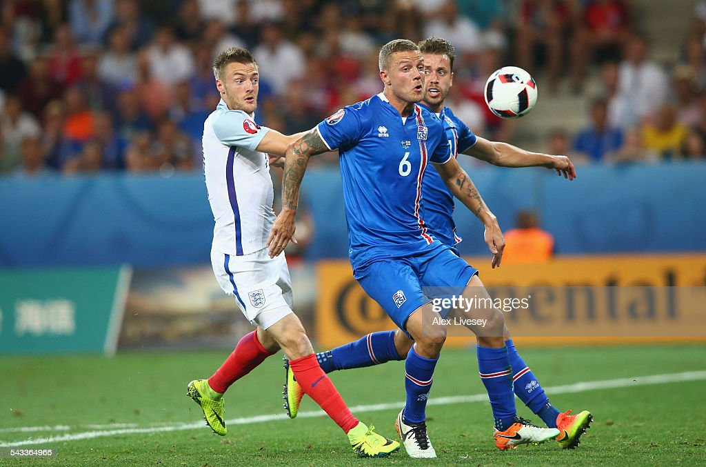 Ragnar Sigurdsson of Iceland and <a gi-track='captionPersonalityLinkClicked' href=/galleries/search?phrase=Jamie+Vardy&family=editorial&specificpeople=8695606 ng-click='$event.stopPropagation()'>Jamie Vardy</a> of England compete for the ball during the UEFA EURO 2016 round of 16 match between England and Iceland at Allianz Riviera Stadium on June 27, 2016 in Nice, France.