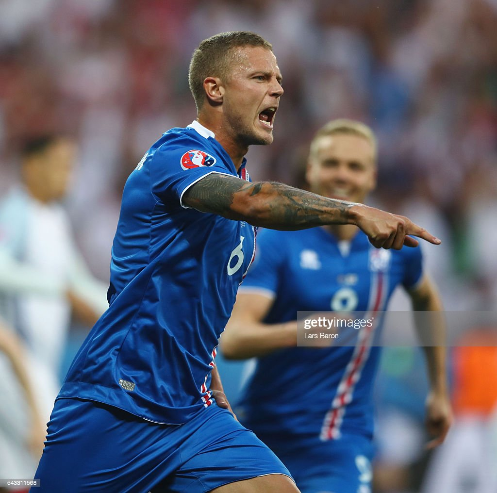 Ragnar Sigurdsson of Iceland celebrates scoring his team's first goal during the UEFA EURO 2016 round of 16 match between England and Iceland at Allianz Riviera Stadium on June 27, 2016 in Nice, France.