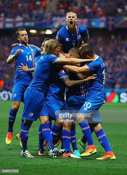 Ragnar Sigurdsson of Iceland celebrates scoring his team's first goal with his team mates during the UEFA EURO 2016 round of 16 match between England...
