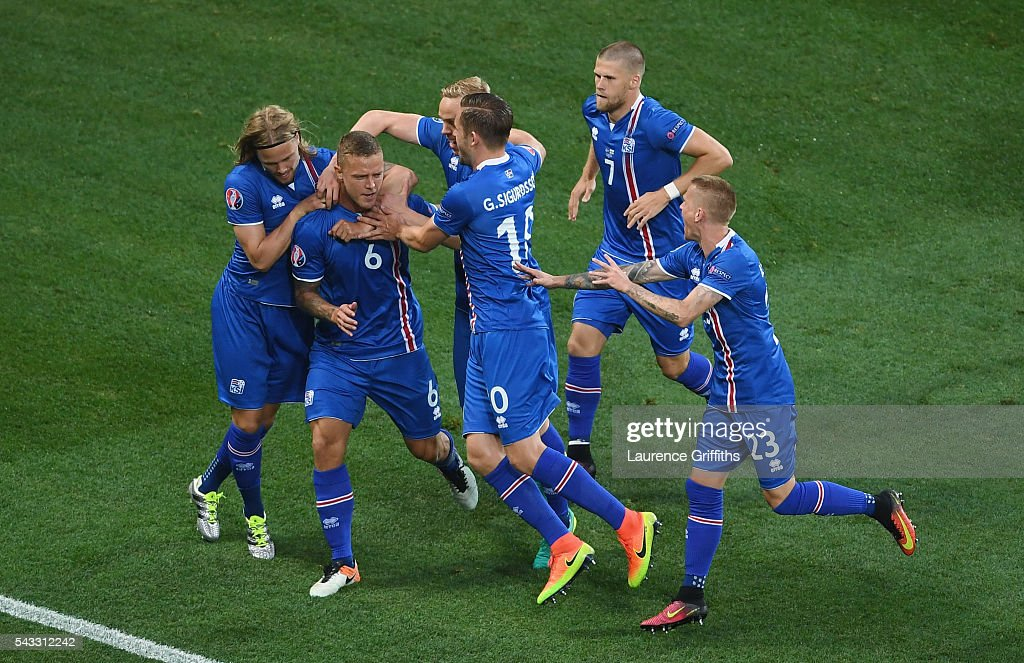 Ragnar Sigurdsson (2nd L) of Iceland celebrates scoring his team's first goal with his team mates during the UEFA EURO 2016 round of 16 match between England and Iceland at Allianz Riviera Stadium on June 27, 2016 in Nice, France.