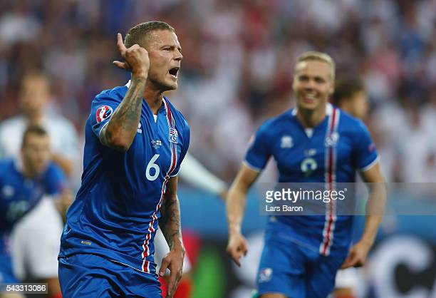 Ragnar Sigurdsson of Iceland celebrates scoring his team's first goal during the UEFA EURO 2016 round of 16 match between England and Iceland at...