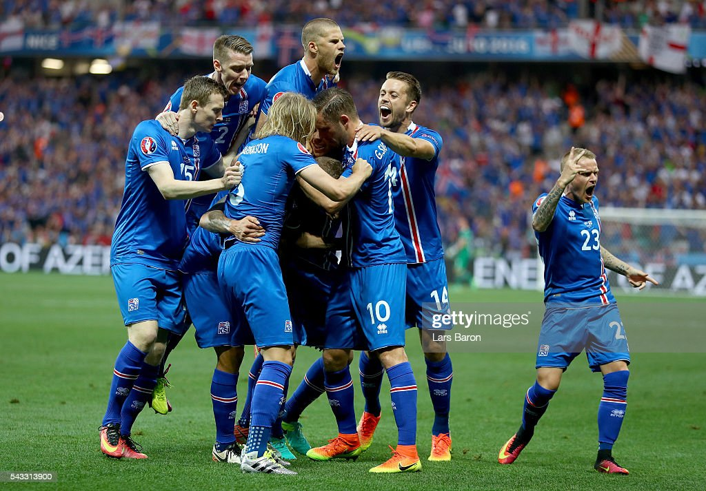 Ragnar Sigurdsson (C, obscured) of Iceland celebrates scoring his team's first goal with his team mates during the UEFA EURO 2016 round of 16 match between England and Iceland at Allianz Riviera Stadium on June 27, 2016 in Nice, France.
