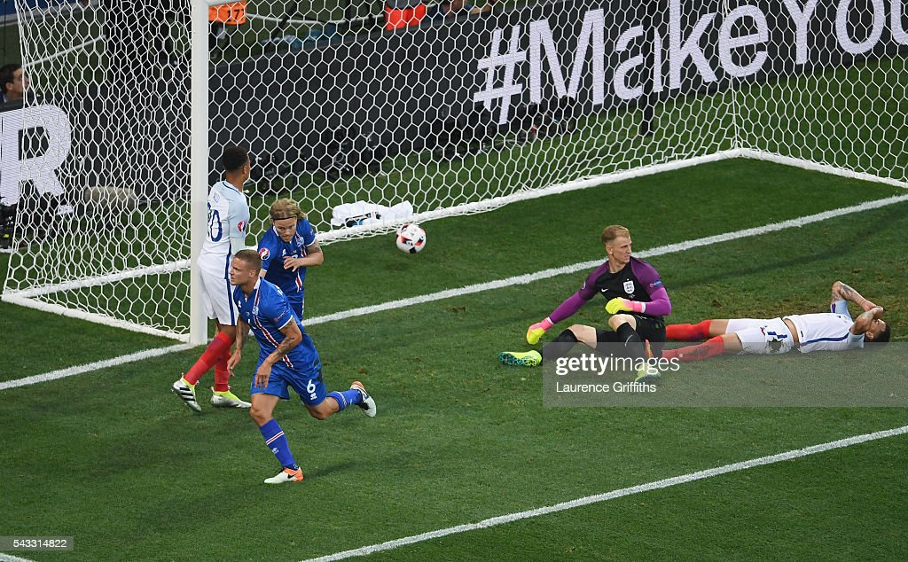 Ragnar Sigurdsson (2nd L) of Iceland celebrates scoring his team's first goal during the UEFA EURO 2016 round of 16 match between England and Iceland at Allianz Riviera Stadium on June 27, 2016 in Nice, France.