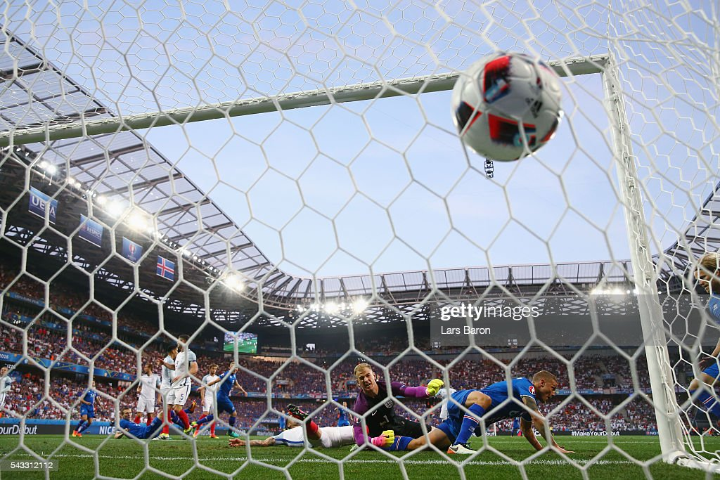 Ragnar Sigurdsson (1st R) of Iceland scores his team's first goal during the UEFA EURO 2016 round of 16 match between England and Iceland at Allianz Riviera Stadium on June 27, 2016 in Nice, France.