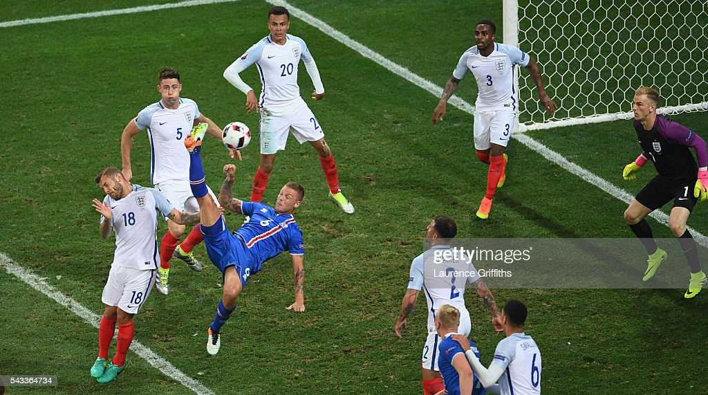 Ragnar Sigurdsson of Iceland shoots wit an overhead kick during the UEFA EURO 2016 round of 16 match between England and Iceland at Allianz Riviera Stadium on June 27, 2016 in Nice, France.