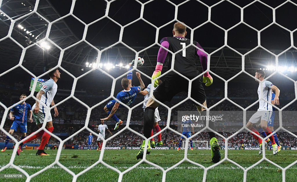 Ragnar Sigurdsson of Iceland shoots with an overhead kick during the UEFA EURO 2016 round of 16 match between England and Iceland at Allianz Riviera Stadium on June 27, 2016 in Nice, France.