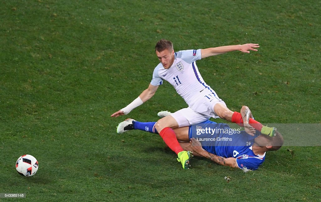 Ragnar Sigurdsson of Iceland tackles <a gi-track='captionPersonalityLinkClicked' href=/galleries/search?phrase=Jamie+Vardy&family=editorial&specificpeople=8695606 ng-click='$event.stopPropagation()'>Jamie Vardy</a> of England during the UEFA EURO 2016 round of 16 match between England and Iceland at Allianz Riviera Stadium on June 27, 2016 in Nice, France.
