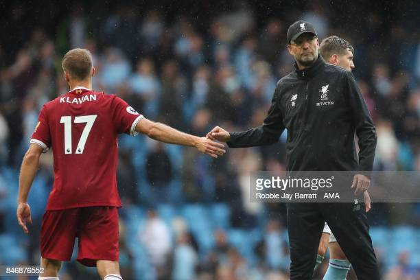Ragner Klavan of Liverpool and Jurgen Klopp manager / head coach of Liverpool dejected during the Premier League match between Manchester City and...