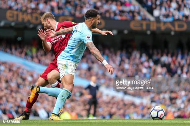 Ragner Klavan of Liverpool and Kyle Walker of Manchester City during the Premier League match between Manchester City and Liverpool at Etihad Stadium...
