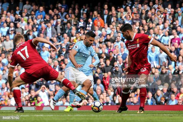 Ragner Klavan of Liverpool and Sergio Aguero of Manchester City during the Premier League match between Manchester City and Liverpool at Etihad...