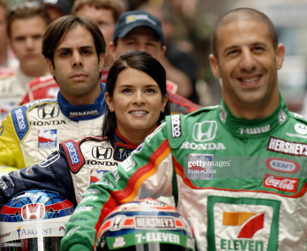 Rahal Letterman Racing driver Danica Patrick (C) of the US, pole-sitter Andretti Green Racing driver Tony Kanaan (R) of Brazil and Rahal Letterman Racing driver Vitor Meira (L) of Brazil join the starting grid of 33 drivers in the Indianapolis 500 for a photograph 23 May 2005 in New York's Times Square. Patrick is the highest qualifying woman in the race's history (4th) and will compete for the first time in the 89th running of the Indianapolis 500 on 29 May 2005. AFP PHOTO/Stan Honda