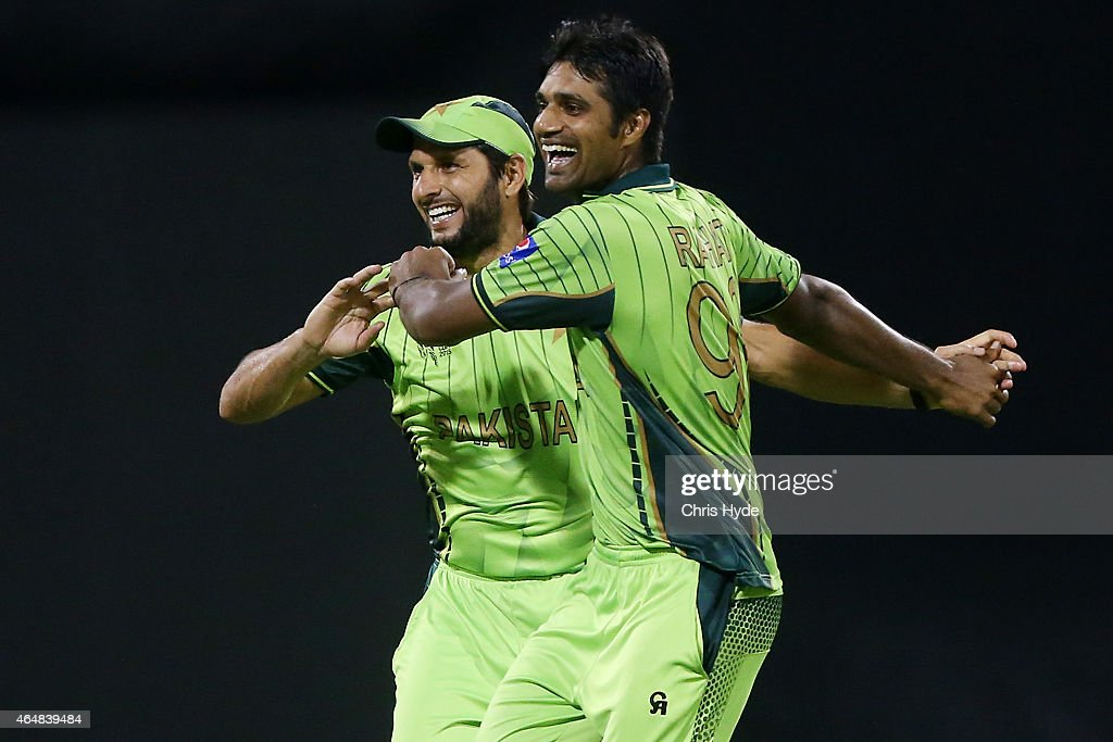 <a gi-track='captionPersonalityLinkClicked' href=/galleries/search?phrase=Rahat+Ali&family=editorial&specificpeople=9407619 ng-click='$event.stopPropagation()'>Rahat Ali</a> of Pakistan celebrates after dismissing <a gi-track='captionPersonalityLinkClicked' href=/galleries/search?phrase=Sean+Williams+-+Cricket+Player&family=editorial&specificpeople=13416292 ng-click='$event.stopPropagation()'>Sean Williams</a> of Zimbabwe during the 2015 ICC Cricket World Cup match between Pakistan and Zimbabwe at The Gabba on March 1, 2015 in Brisbane, Australia.