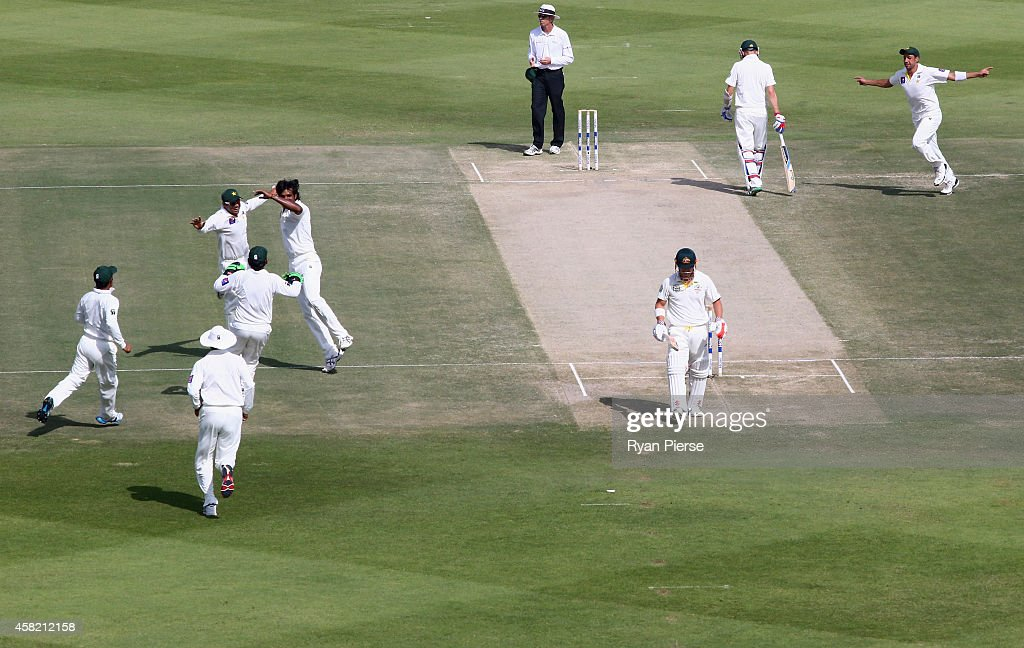 <a gi-track='captionPersonalityLinkClicked' href=/galleries/search?phrase=Rahat+Ali&family=editorial&specificpeople=9407619 ng-click='$event.stopPropagation()'>Rahat Ali</a> of Pakistan celebrates after taking the wicket of <a gi-track='captionPersonalityLinkClicked' href=/galleries/search?phrase=David+Warner+-+Cricketer&family=editorial&specificpeople=4262255 ng-click='$event.stopPropagation()'>David Warner</a> of Australia during Day Two of the Second Test between Pakistan and Australia at Sheikh Zayed Stadium on November 1, 2014 in Abu Dhabi, United Arab Emirates.