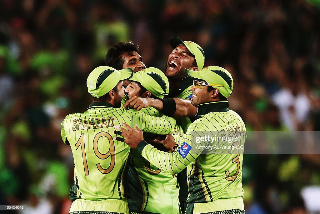 <a gi-track='captionPersonalityLinkClicked' href=/galleries/search?phrase=Rahat+Ali&family=editorial&specificpeople=9407619 ng-click='$event.stopPropagation()'>Rahat Ali</a> of Pakistan is mobbed by his teammates after taking the wicket of David Miller of South Africa during the 2015 ICC Cricket World Cup match between South Africa and Pakistan at Eden Park on March 7, 2015 in Auckland, New Zealand.