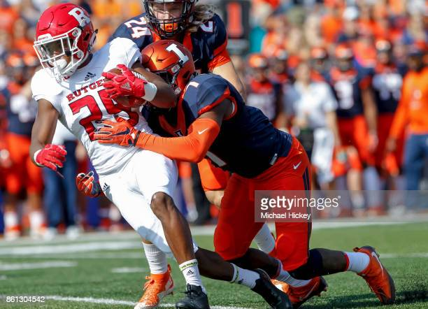 Raheem Blackshear of the Rutgers Scarlet Knights runs the ball as Stanley Green of the Illinois Fighting Illini tries to hang on for the stop at...
