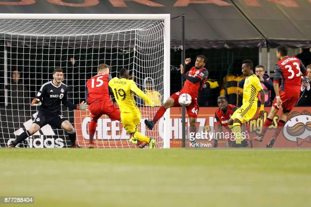 Raheem Edwards of the Toronto FC blocks a shot from Kekuta Manneh of the Columbus Crew SC during the second half at MAPFRE Stadium on November 21...