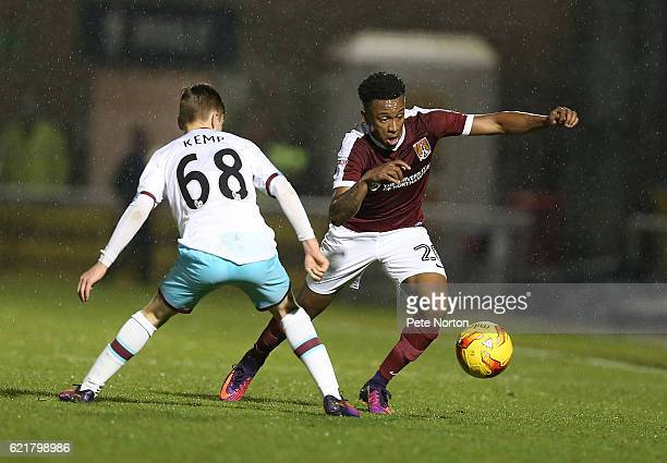 Raheem Hanley of Northampton Town attempts to move with the ball past Dan Kemp of West Ham United U21 during the EFL Checkatrade Trophy match between...