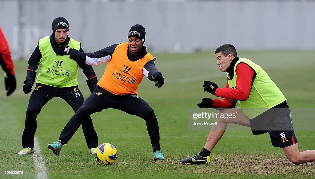Raheem Sterling and Conor Coady of Liverpool in action during a training session at Melwood Training Ground on January 17, 2013 in Liverpool, England.