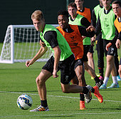 Raheem Sterling and Daniel Cleary of Liverpool in action during a training session at Melwood Training Ground on October 17 2014 in Liverpool England