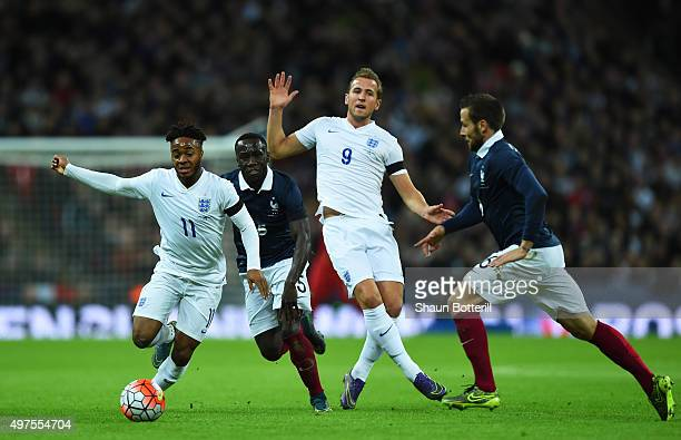 Raheem Sterling and Harry Kane of England Bacary Sagna and Yohan Cabaye of France compete for the ball during the International Friendly match...