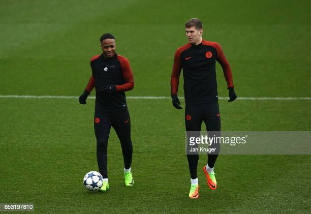 Raheem Sterling and John Stones warm up during a Manchester City training session prior to the UEFA Champions League Round of 16 Second Leg match...