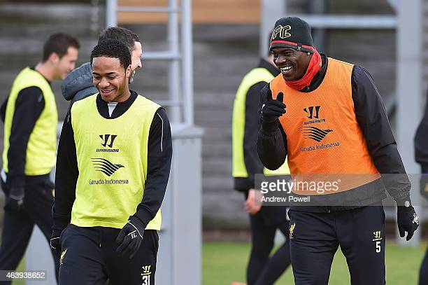 Raheem Sterling and Mario Balotelli of Liverpool during a training session at Melwood Training Ground on February 20 2015 in Liverpool England