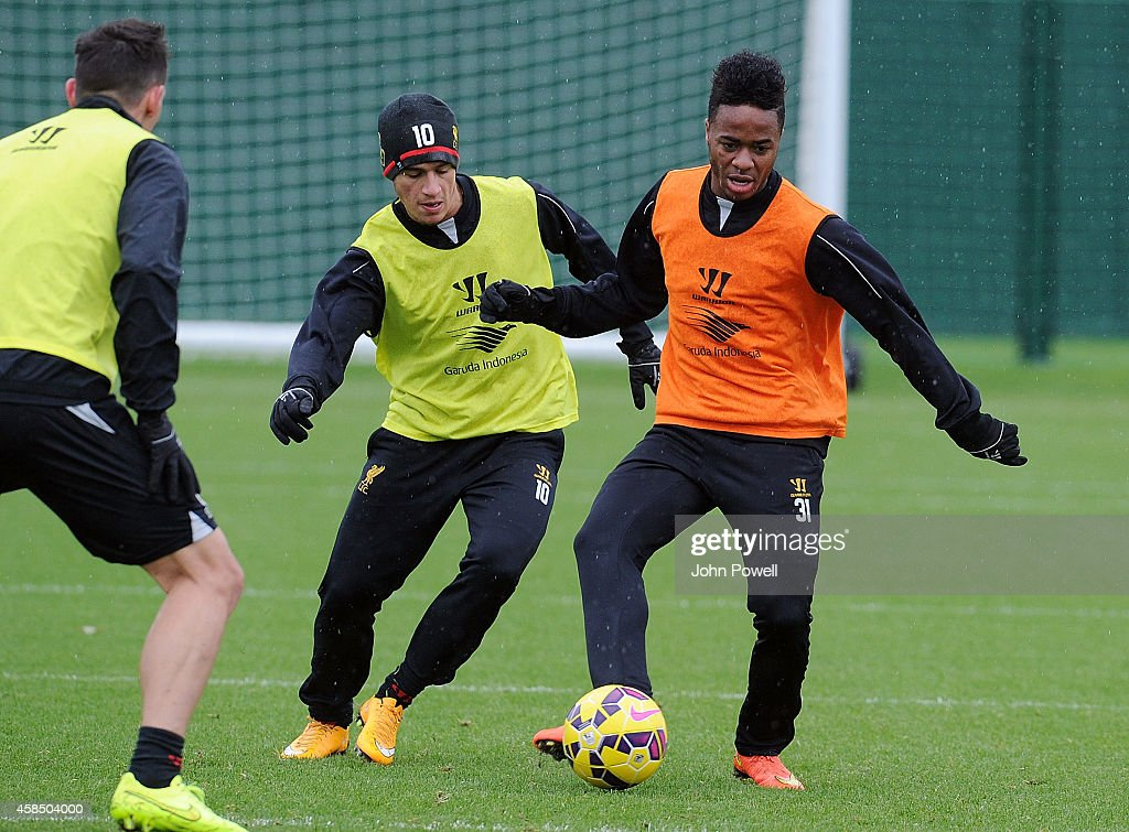 Raheem Sterling and Philippe Coutinho of Liverpool in action during a training session at Melwood Training Ground on November 6, 2014 in Liverpool, England.