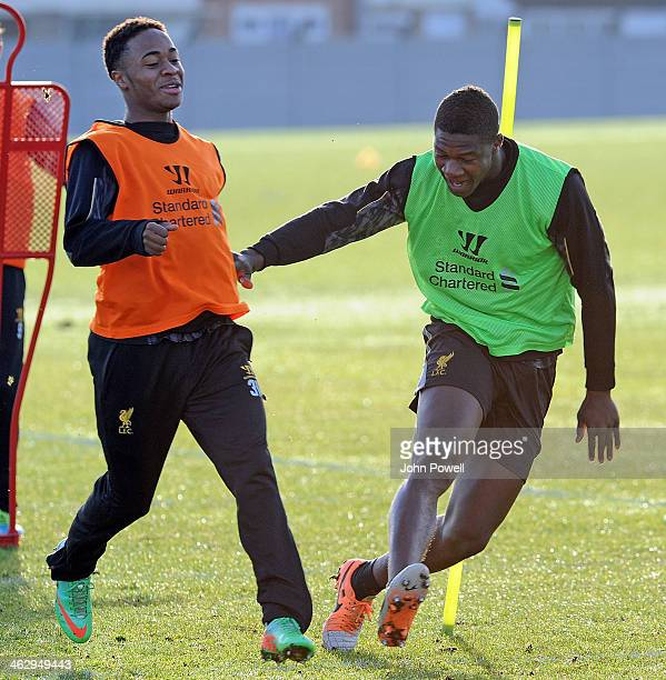 Raheem Sterling and Stephen Sama of Liverpool in action during a training session at Melwood Training Ground on January 16 2014 in Liverpool England