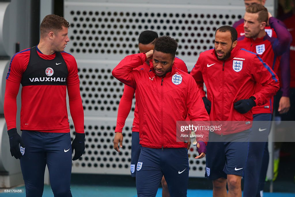 Raheem Sterling and the England Squad walk out to training during the England training session at Manchester City Football Academy on May 25, 2016 in Manchester, England.